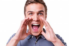 picture of shout  - Happy young man holding hands near mouth and shouting while standing isolated on white background - JPG
