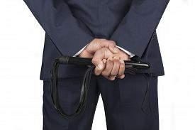 image of domination  - Leather whip held by dominant master in a suit - JPG