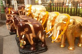 foto of brahma  - Carved wooden elephant People bring offerings to Erawan Shrine  - JPG