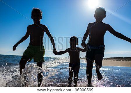 Fun kids playing splash at beach