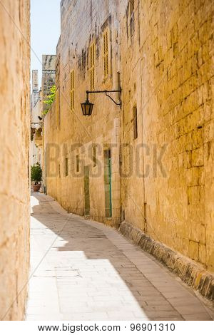 traditional narrow silent street in Maltese Mdina