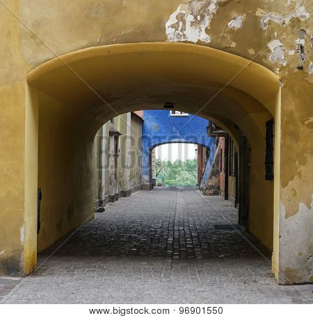 blue archway in historical part of Warsaw