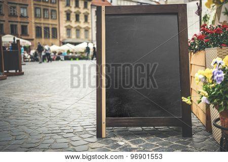 menu advertising board near an eatery