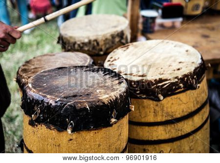 old wooden ethnic drums outdoors