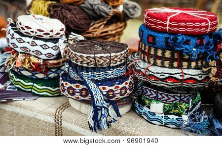 various colorful decorative knitted ribbons in hanks