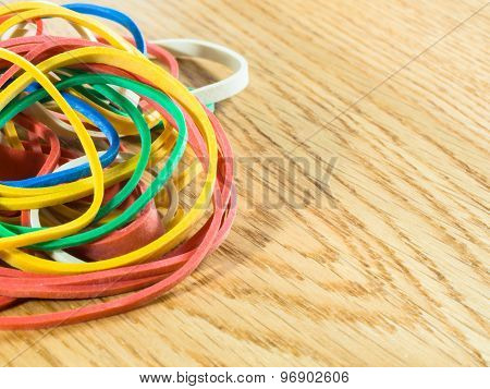 Colored Elastic Bands On Wooden Background