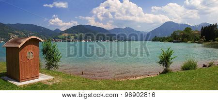 Beach With Wooden Beach Chair At Lakeside Tegernsee, Bavaria