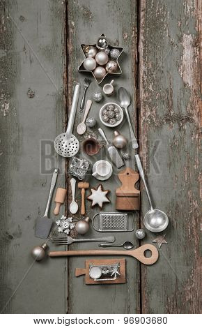 Christmas tree of cutlery and tableware in old vintage style for decoration.