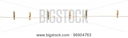 Old Wooden Clothespins On A Rope Isolated
