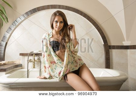 Sexy Woman Sitting On Bath Tub