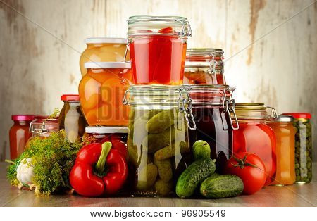 Jars With Pickled Vegetables And Fruity Compotes