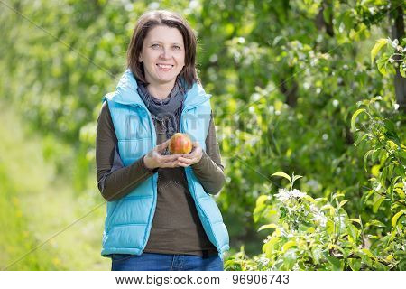 Beautiful Smiling Woman In Orchard