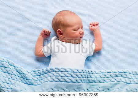 Newborn Baby Boy Under A Blue Blanket