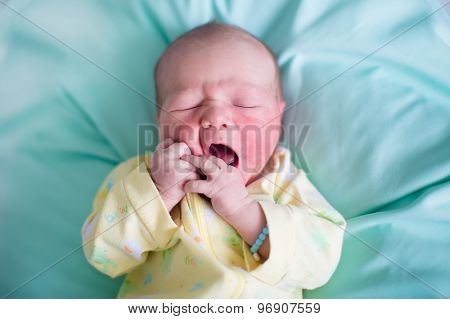 Newborn Baby On A Green Blanket