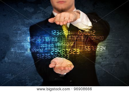 Businessman holding a shining number cloud in front of his body