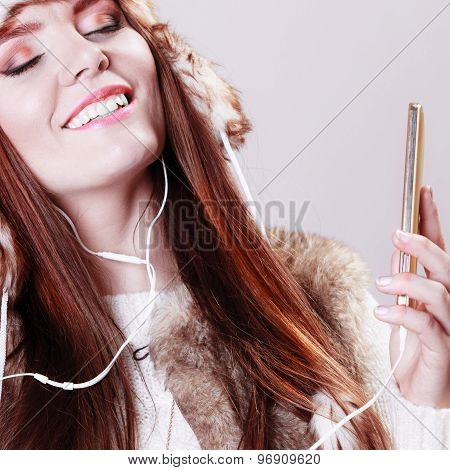 Woman With Smart Phone Listening Music