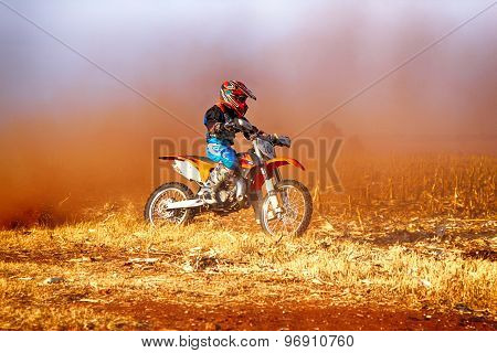 Hd - Junior Motorbike Kicking Up Trail Of Dust On Sand Track During Rally Race.