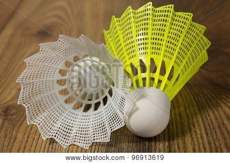 Shuttlecocks For Badminton On A Wooden Floor