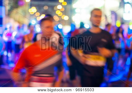 Blurred Night marathon runners. Sport background
