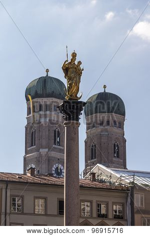 Marian Column Of Munich At Marienplatz With The Frauenkirche In The Background, Germany, 2015