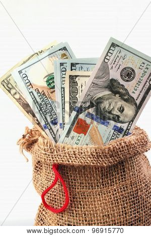 Dollars In The Bag As A Symbol Of Economic Growth And Success
