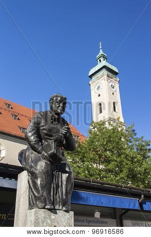Munich, Germany - June 04, 2015: Statue of Elise Aulinger at the Viktualienmarkt in Munich, a typical farmer's market