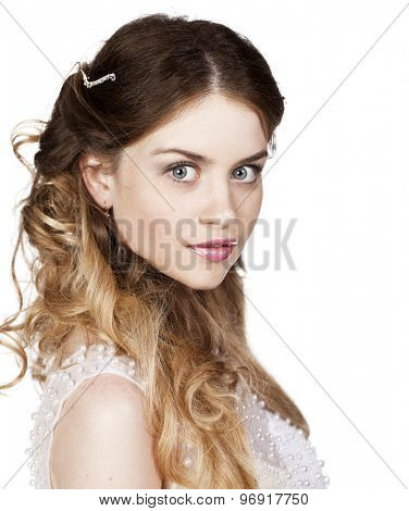 Studio portrait of a beautiful blonde close up with bright makeup on a white background isolated