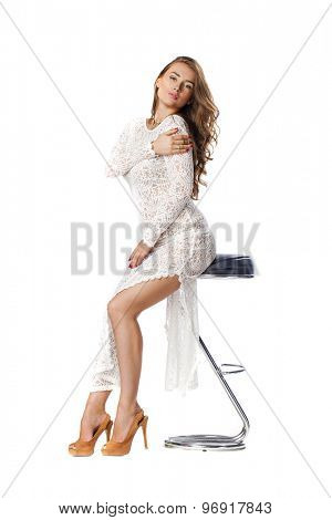 Fashion beautiful young woman with modern white dress posing in studio, isolated on white