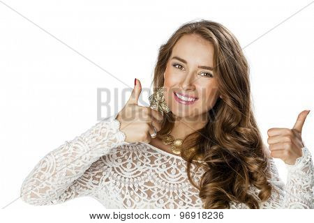 Portrait of happy smiling young beautiful woman in white casual clothing, showing thumbs up gesture, over white background