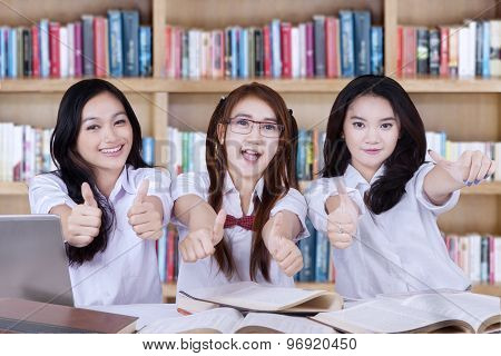 Group Of Lovely Students With Thumbs Up
