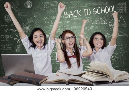 Happy Schoolgirls Celebrate Back To School