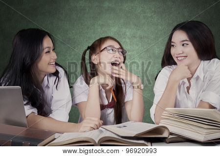 Lovely Schoolgirls Talking In The Class