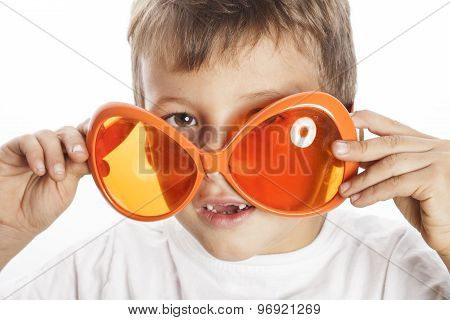 little cute boy in orange sunglasses pointing isolated