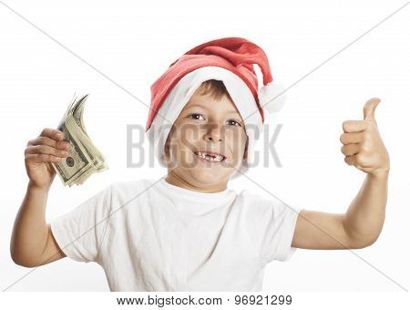 little cute boy in santas red hat isolated with cash