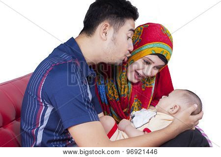 Muslim Couple Playing With Cute Baby