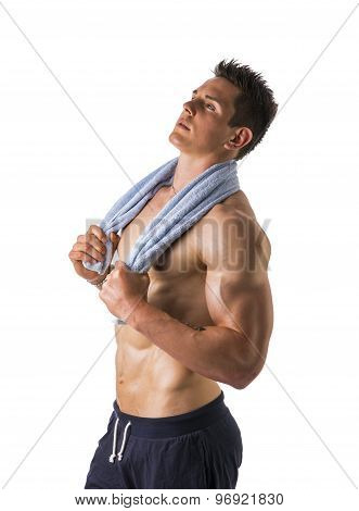 Handsome power athletic young man holding towel