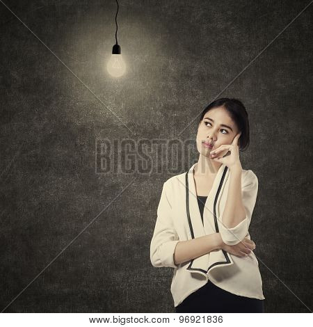 Pretty Woman Thinking Under Lightbulb 1