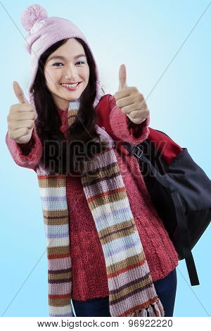 Student In Winter Clothes Showing Thumbs-up