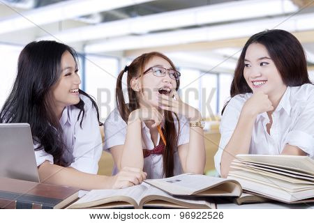 Three Students Back To School And Talking In Class