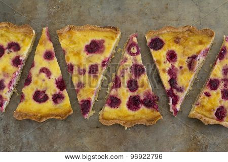 Raspberry and White Chocolate Tart Sliced on Tray