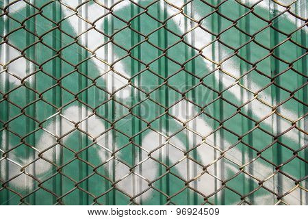 old steel net pattern and dirty green zinc wall