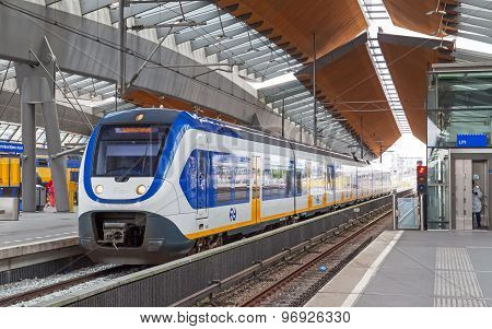 White-blue Train Stays On Amsterdam Arena Station