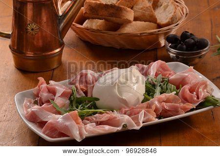 Sliced ham and mozzarella cheese dish.