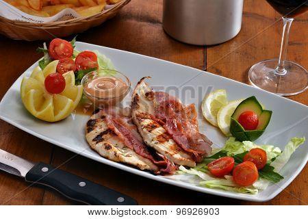 grilled chicken and prosciutto ham dish.