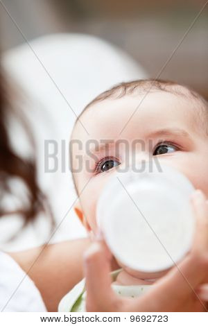 Close-up Of A Baby Boy Bottle-fed By His Mother At Home