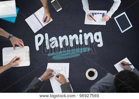 The word planning and business meeting against blackboard