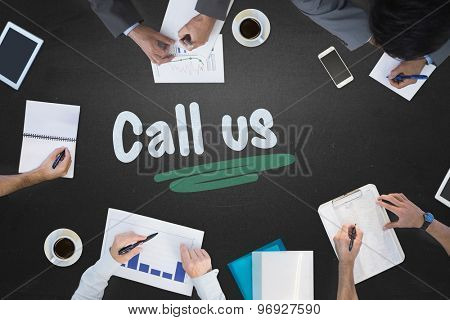 The word call us and business meeting against blackboard