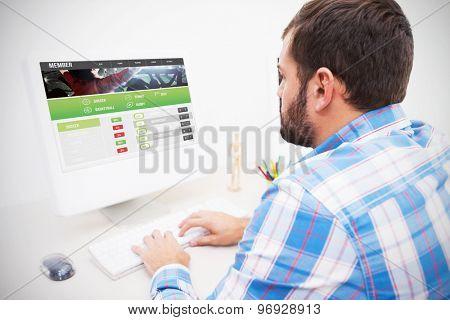 Gambling app screen against casual businessman working at his desk