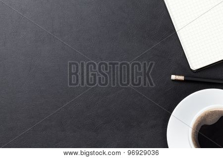 Office leather desk table with supplies and coffee cup. Top view with copy space