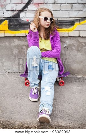 Blond Teenager Girl With Lollipop, Vertical Urban Outdoor Portrait